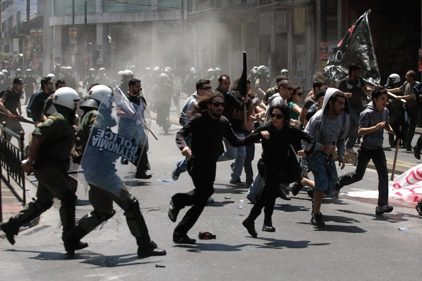 Greeks protests, and riot police trying to calm them down