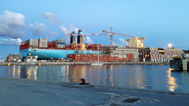 A giant cargo ship being loaded with crates in Denmark