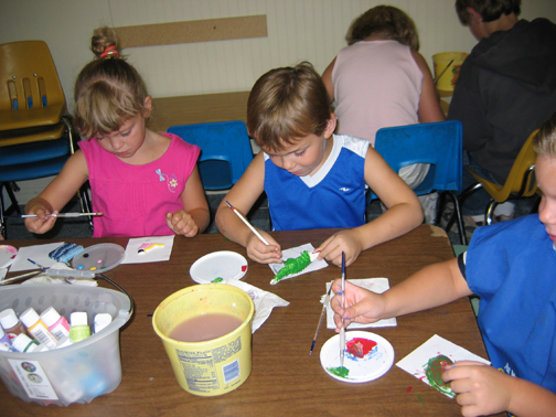Children painting at daycare