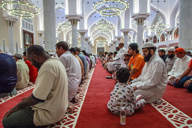 Many members of a mosque praying late into the night