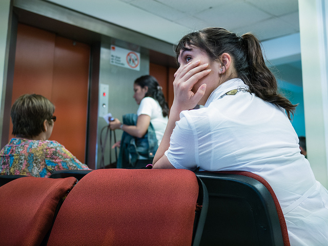 A woman in the waiting room at the hospital