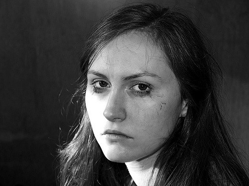 A woman looking highly depressed