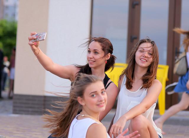 Girls taking a selfie on the street