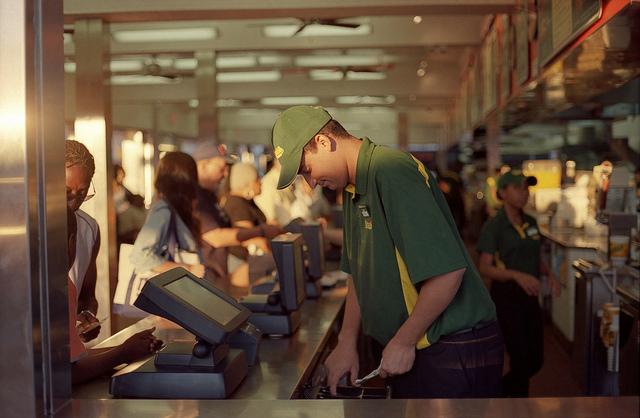 A cashier taking a customer's money