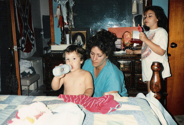 A mother attending to her two children