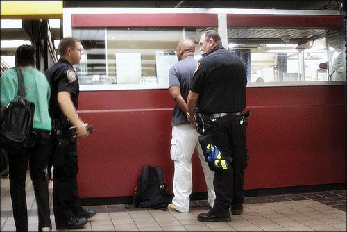 A man being handcuffed and arrested