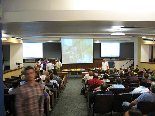 A classroom of students all watching a movie on the projector