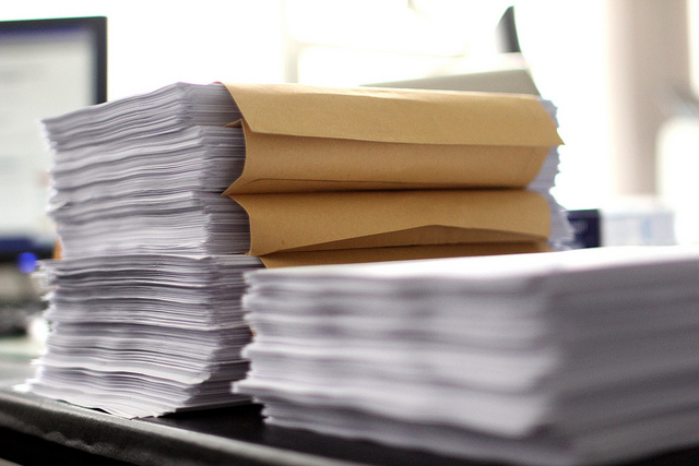 A tall stack of papers