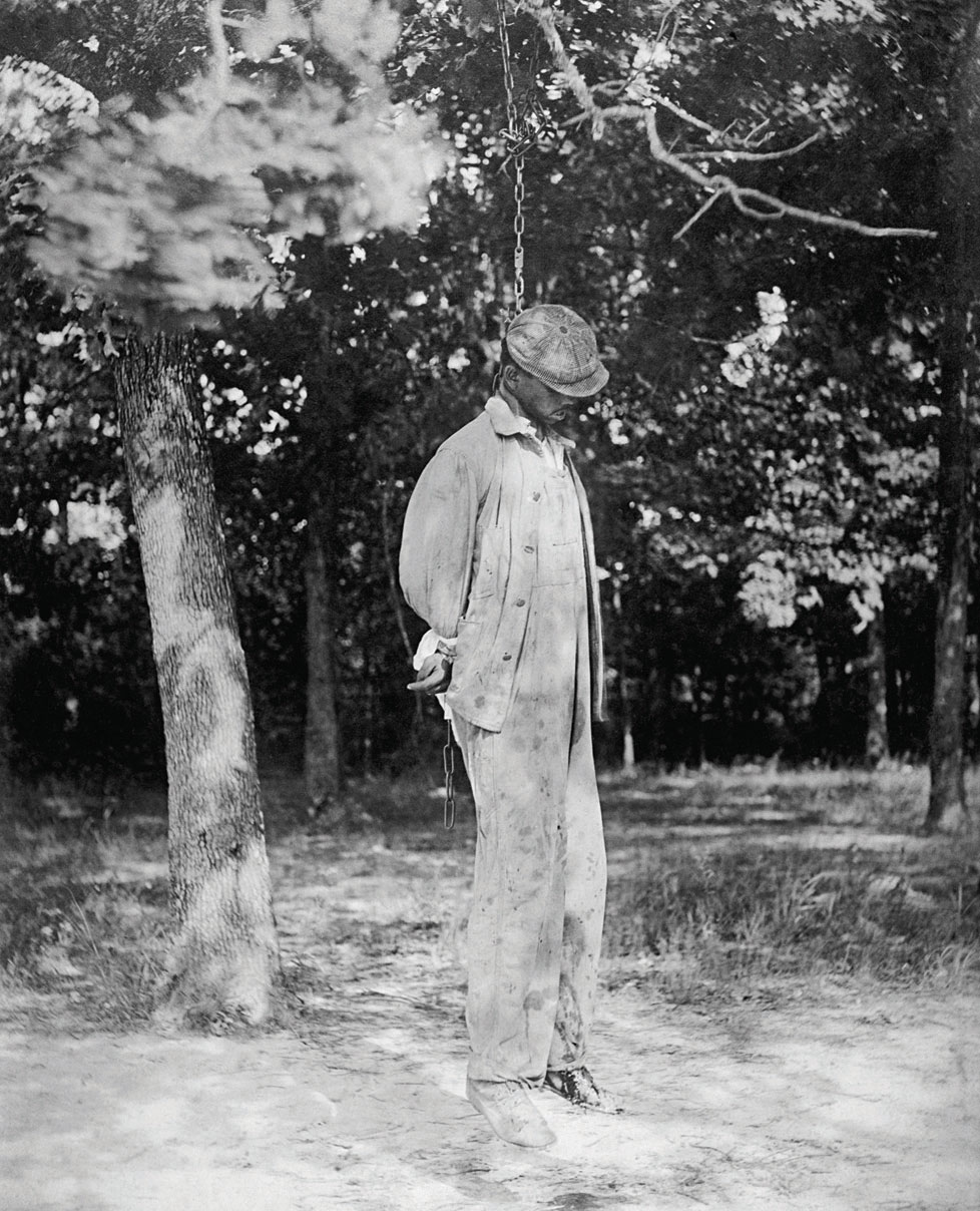 An African American man hanging from a noose. A victim of a lynching