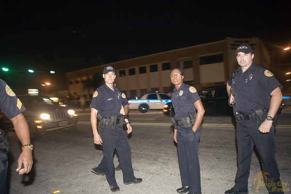Four police officers standing on the street