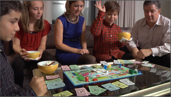 Kids Playing Monopoly with their parents