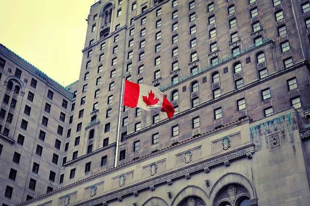 A Canadian Flag outside of a building in Toronto