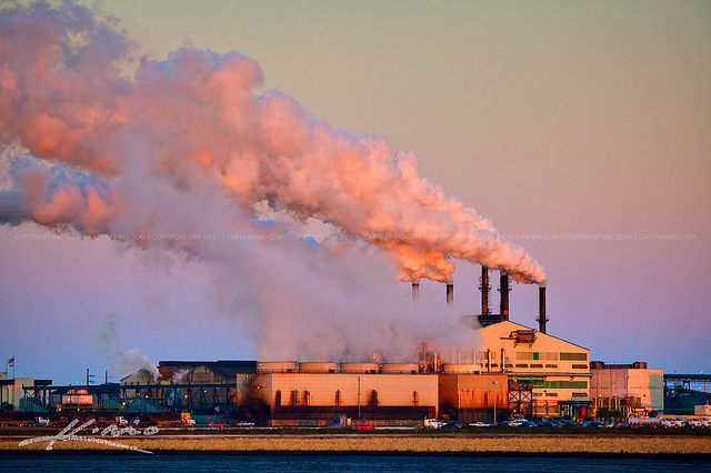A sugar factory producing smoke pollution into the Earth