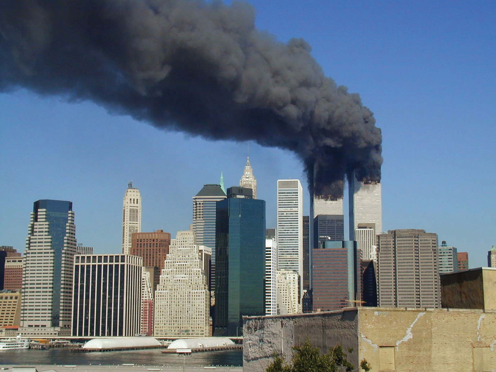 The twin towers still smoking, before they crumbled