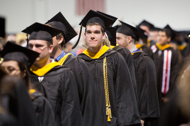 A line of college graduates in their gowns