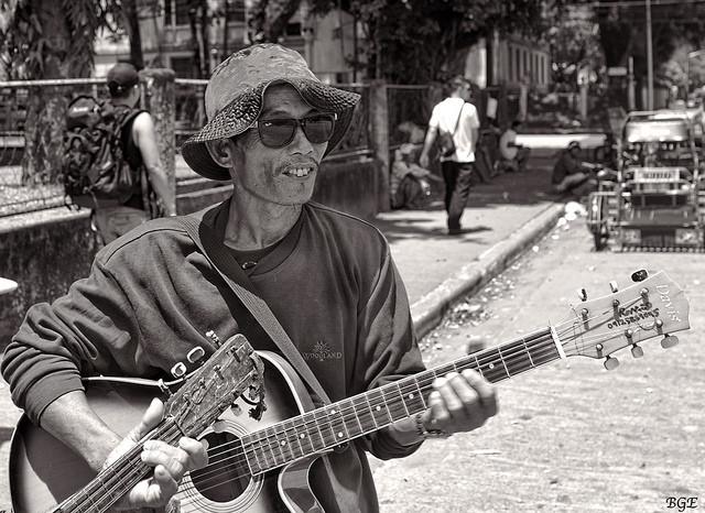 A street Musician holding his guitar