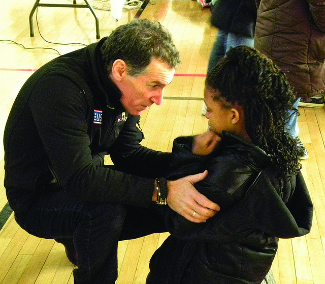 A man harshly disciplining a young girl