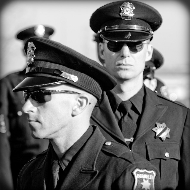 Cops stand in line at an Oakland Police Memorial