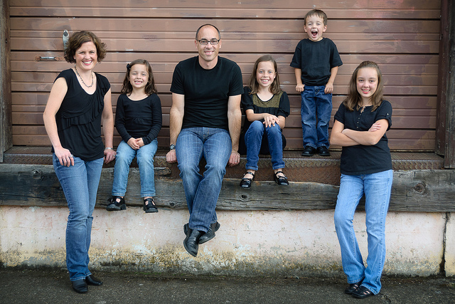 A white family smiling for family pictures