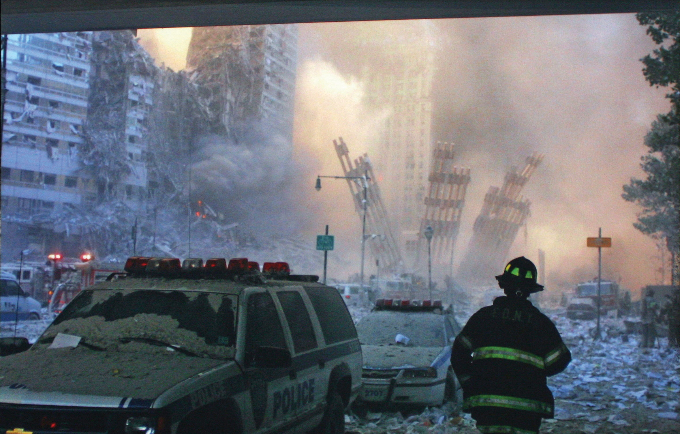 A firefighter standing in the remnants of the world trade center, after both towers collapsed