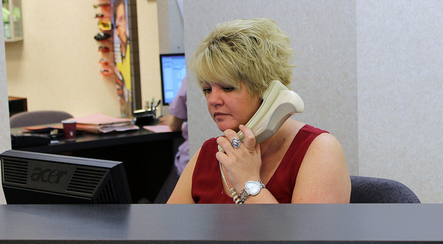 receptionist answering phone at suburban eye care