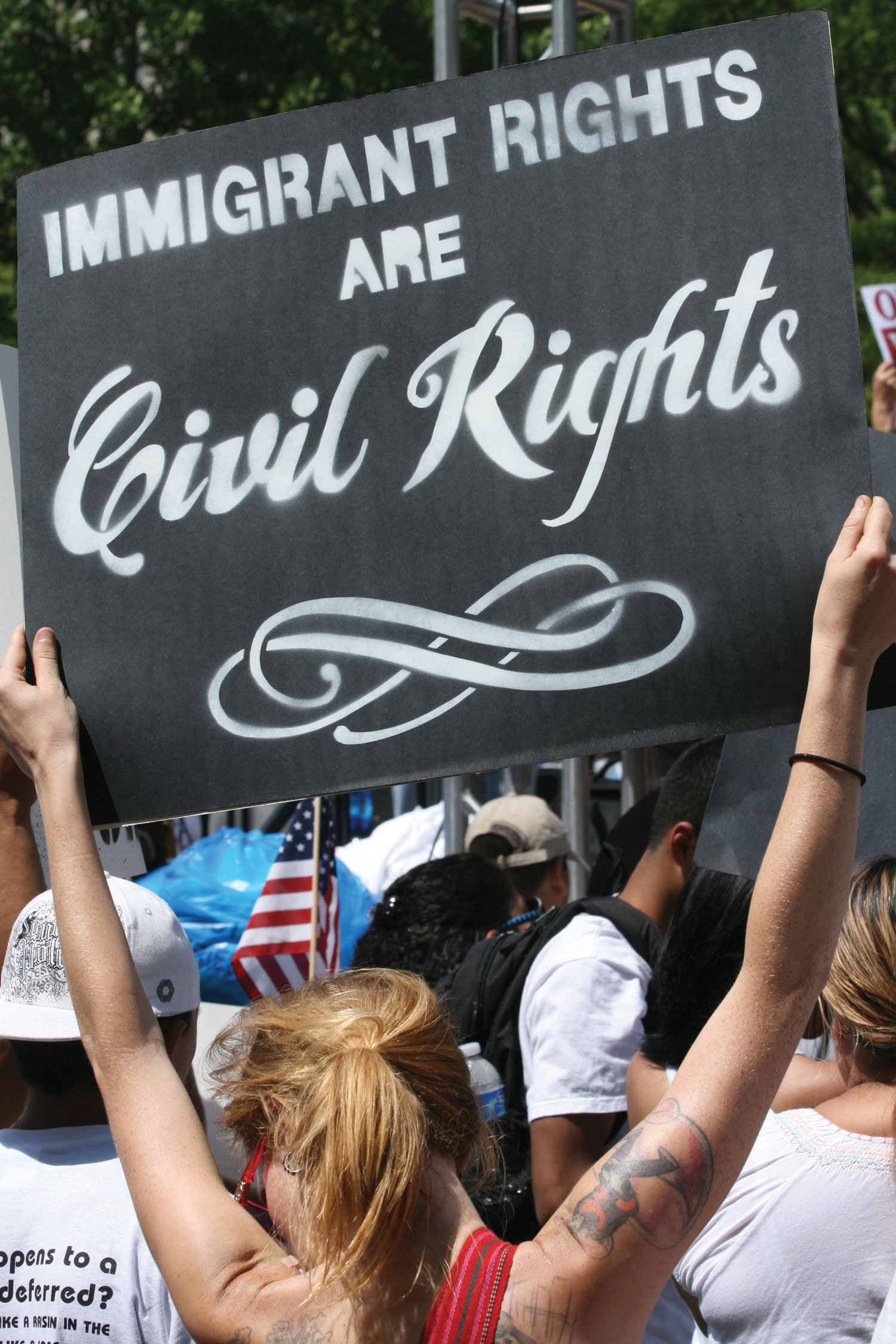 A protest of Immigration Reform. A woman holds up a sign