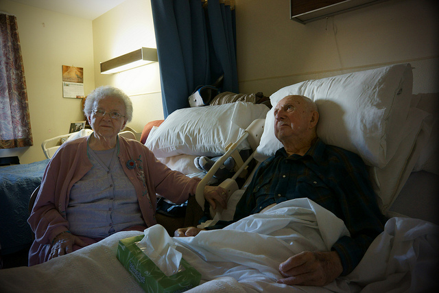 An elderly couple at a hospital together
