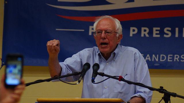 Bernie Sanders speaking at a political rally