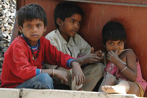 Three children from a poor nation, hanging out on the street