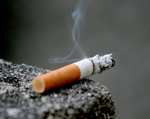 A cigarette slowly burning out