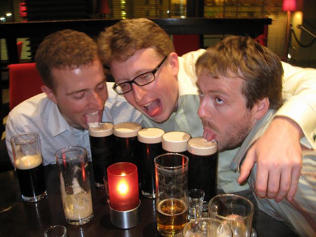 Three men tackling 5 glasses of beer