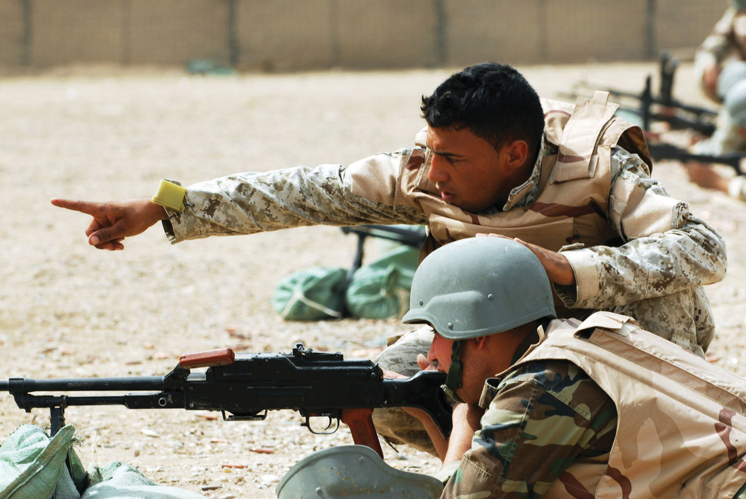 Soldiers doing some target practice in the prone position