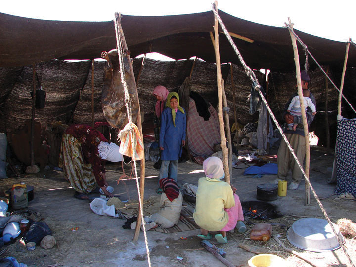 A photo illustrating the Nomad's Simple Life. Tarps are supported by sticks and ropes to create shade from the devastation caused by greenhouse gases