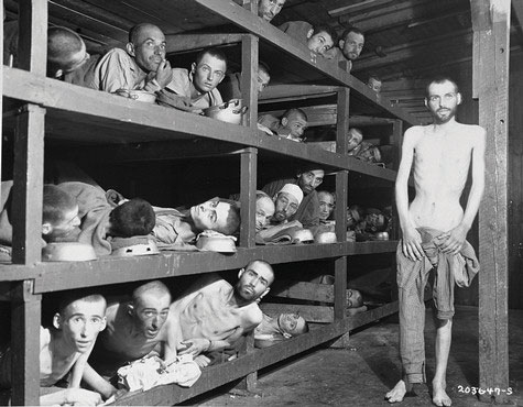Jewish prisoners at a concentration camped. Malnutrition is evident, and one man is just skin and bones