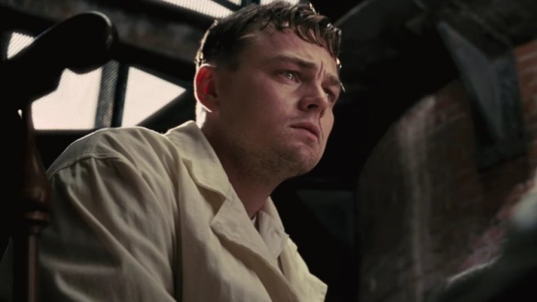 """Picture of Leonardo DiCaprio in the movie """"Shutter Island."""" He has a worried, intense stare."""