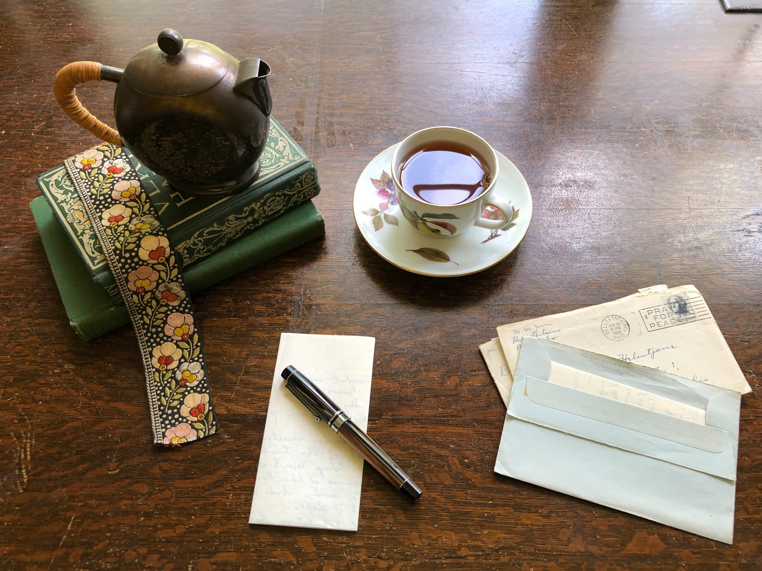 photo of different types writing: books, letters, lists